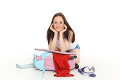 Young woman with suitcase. Stock Photo