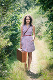 Young woman with a suitcase Stock Images