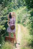 Young woman with a suitcase Royalty Free Stock Photos