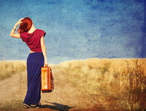 Young woman with suitcase Royalty Free Stock Photography