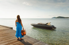 Young woman with suitcase on the pier Stock Photography