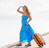 Young woman with suitcase on the pier Royalty Free Stock Photo