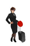 Young woman with suitcase and red hat. Elegant young woman in sunglasses stands with suitcase and red hat in hand isolated on white background Royalty Free Stock Image