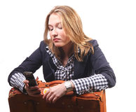 Young woman with suitcase and telephone stock image