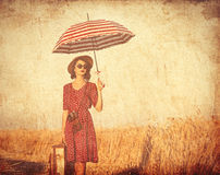 Young woman with suitcase, umbrella and camera Royalty Free Stock Images