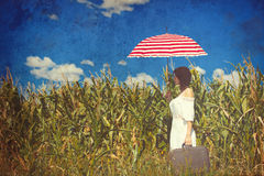 Young woman with suitcase and umbrella Stock Photos