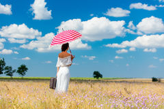 Young woman with suitcase and umbrella Royalty Free Stock Image