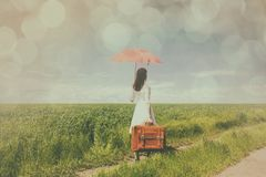 Young woman with suitcase and umbrella Stock Photography
