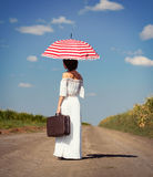 Young woman with suitcase and umbrella Royalty Free Stock Images