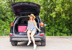 Young woman and suitcase. Vacation concept. Car trip. Summer travel. Girl traveling with suitcases.  Stock Photography
