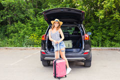 Young woman and suitcase. Vacation concept. Car trip. Summer travel. Girl traveling with suitcases.  Royalty Free Stock Photos