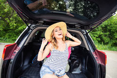 Young woman and suitcase. Vacation concept. Car trip. Summer travel. Girl traveling with suitcases.  Stock Image