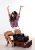 Young woman and   suitcases Royalty Free Stock Images