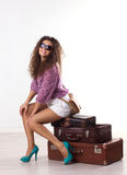 Young woman with  suitcases Stock Photography