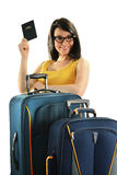 Young woman with suitcases isolated on white. Young smiling woman with suitcases and passport isolated on white background Royalty Free Stock Photos