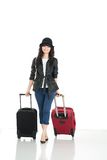 Let's travel!. Young woman with suitcases isolated on a white background Royalty Free Stock Image