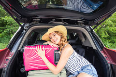 Young woman with suitcases. Vacation concept. Car trip. Summer travel. Stock Photos
