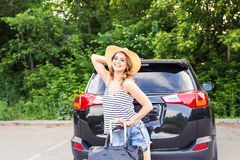 Young woman with suitcases. Vacation concept. Car trip. Summer travel. Stock Photography