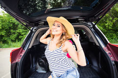 Young woman with suitcases. Vacation concept. Car trip. Summer travel. Stock Photo