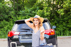 Young woman with suitcases. Vacation concept. Car trip. Summer travel. Royalty Free Stock Image