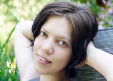 Young woman in summer. Young woman portrait in summer sitting in the garden stock image
