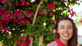 Young woman in the summer on a background of beautiful exotic flowers stock video footage
