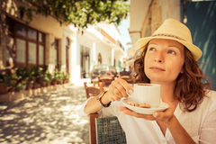 Young woman in summer cafe Stock Photography