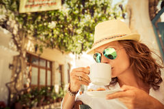 Young woman in summer cafe Stock Photo