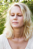 Young woman in summer daydreaming Royalty Free Stock Photos