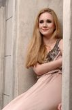 Young woman in summer dress against old stone wall Royalty Free Stock Images