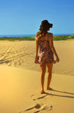 Young woman in Summer dress  on beach Royalty Free Stock Photography