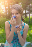 Young woman in summer dress holding a cup of tea stock photo