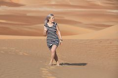 Young woman walking around desert. stock image