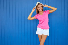 Young woman. Summer fashion. Colorful portrait of pretty young woman. Blue background Stock Images