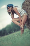 Young woman in a summer field Stock Photos