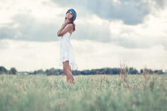 Young woman on a summer field. Soft bright colors Stock Image