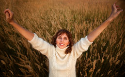 Young woman on summer field. Stretching up Royalty Free Stock Photos