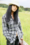 Young woman in summer field. Close up Royalty Free Stock Photography
