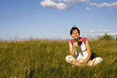 Young woman in summer field. Young woman with wild flowers in meadow Royalty Free Stock Images
