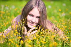 Young woman on a summer field. Focus on hand Stock Image