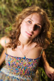 Young woman on a summer field. Shallow dof effect Stock Image
