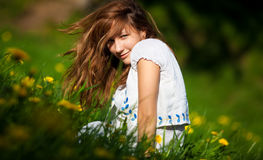 Young woman on a summer field. Shallow dof Stock Image