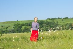 Young woman on summer field portrait Stock Images