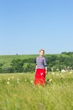 Young woman on summer field portrait Royalty Free Stock Photos