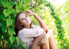 Young woman in the summer garden Stock Image