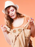 Young woman in summer hat with handbag Stock Photography
