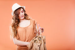 Young woman in summer hat with handbag Stock Photo