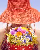 Young woman on the summer meadow with basket of Stock Photos