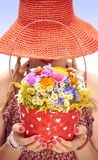 Young woman on the summer meadow with basket of Royalty Free Stock Photos