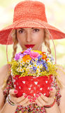 Young woman on the summer meadow with basket of Stock Photo